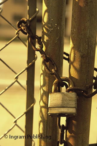 Close-up of a padlock on a gate