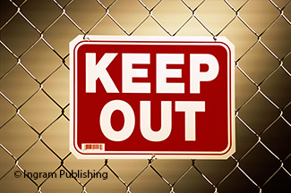 Keep out sign on a chain-link fence