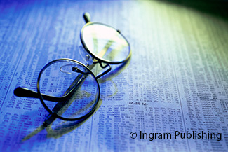 Eyeglasses on a newspaper